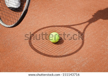 tennis racket shadow with ball
