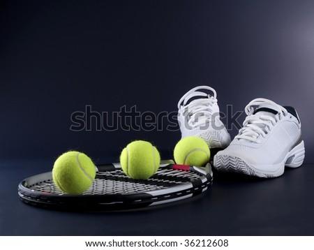 tennis racket three balls and shoes