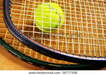 tennis rackets and a tennis ball, closeup
