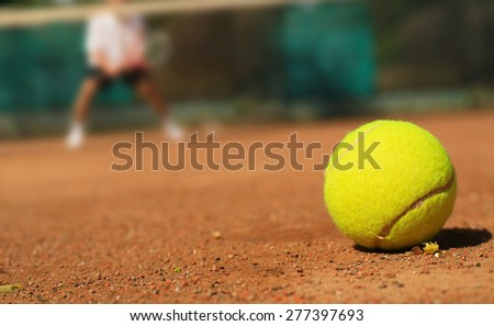 Tennis tennis ball on the ground and the player