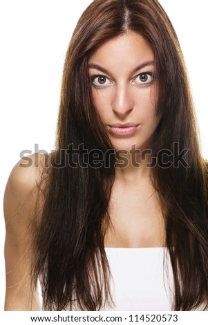 tense looking beautiful brunette woman with long hair