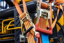 tension safety belts with mechanical locks. stretch textile slings hold the load