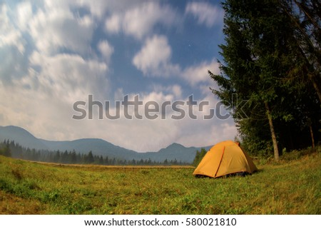 Tent at night on a background of mountains #580021810