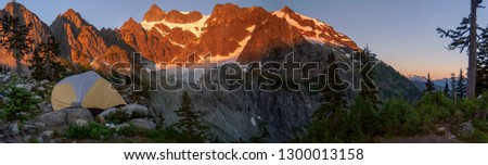 Tent Camping at Lake Ann and Curtis Glacier at the Foot of the Imposing Mount Shuksan. Lower Curtis Glacier is in North Cascades National Park. The glacier is on the western slopes of Mount Shuksan.