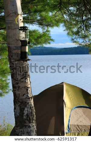 Tent Camping on Shore of a Wilderness Lake