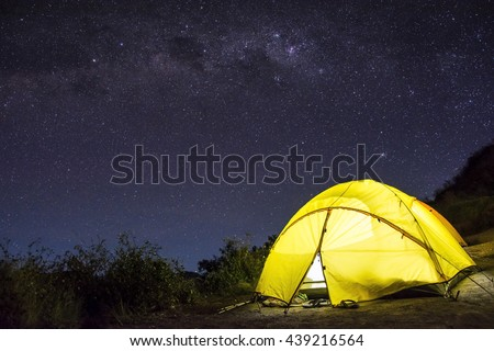 Tent camping under starry night