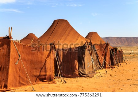 Tent house in desert in a row covered with brown cloth #775363291