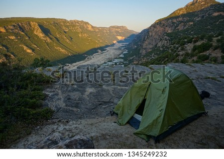 Tent in mountains #1345249232