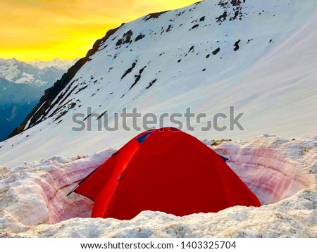 Tent in mountains in the snow #1403325704
