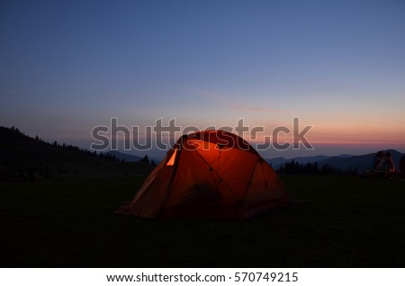 tent in mountains night #570749215