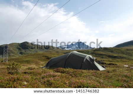 Tent in mountains under power lines #1451746382
