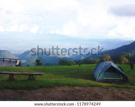 Tent in the middle of the valley #1178974249