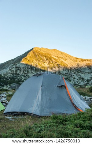 tent in the mountains at sunrise #1426750013