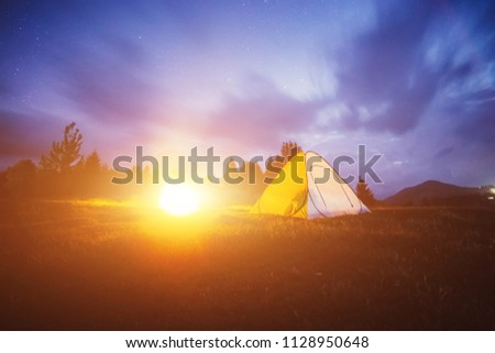 Tent in the mountains. Night photo  #1128950648