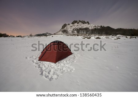 tent in the snow on a cold night