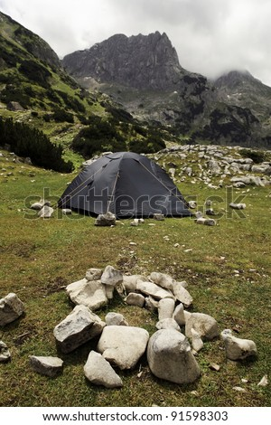 Tent into the wild and place for fire