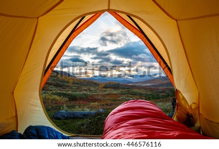 Tent lookout in the Morning on a hiking Tour in Northern Sweden #446576116