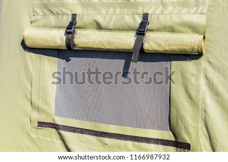 tent military or tourist tents with a window. Background #1166987932