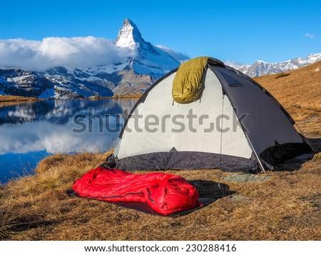 Tent near Matterhorn during early morning with relfection in StelliSee, Zermatt, Switzerland #230288416