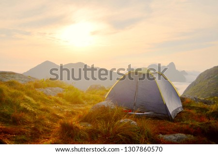 Tent on mountain during sunrise #1307860570