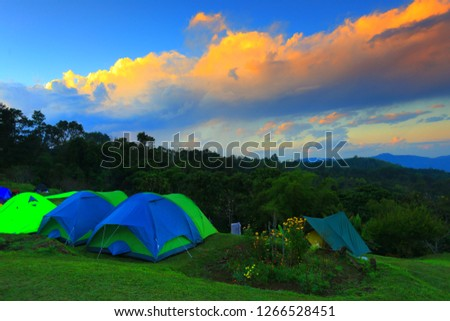 Tent on mountains sunset.selective focus. #1266528451