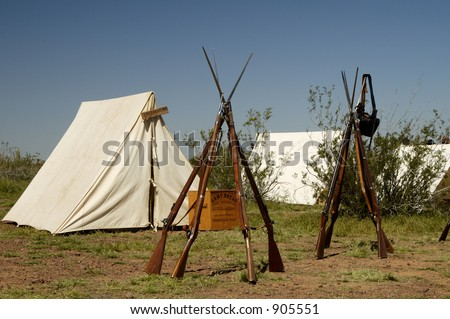 Tents and rifles in a civil war encampment.