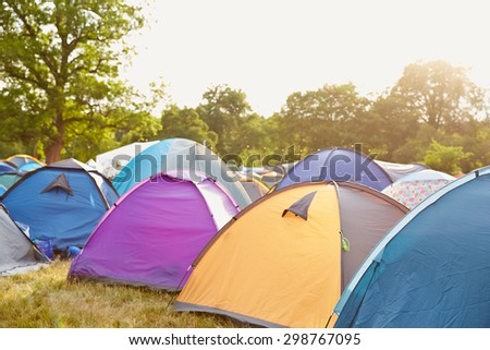 Tents at a music festival campsite #298767095