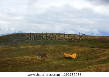 Tents in mountains. Tourist traveler with backpack. Svaneti. Georgia #1393987286