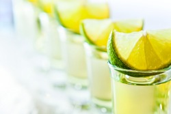tequila and lime , macro shot , focus on foreground