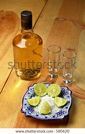 tequila bottle and stuff on a wood table
