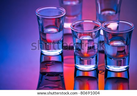 tequila shot glasses in mixed light