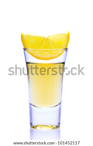 tequila shot with lemon isolated on white background