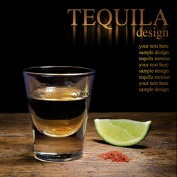 Tequila shot with lime and salt on vintage background.