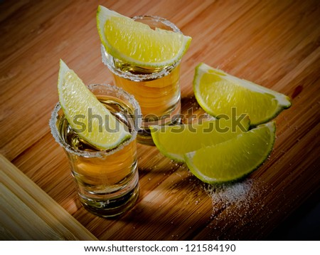 Tequila shots with salt rims and lime wedges