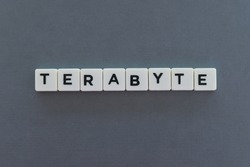 Terabyte word made of square letter word on grey background.
