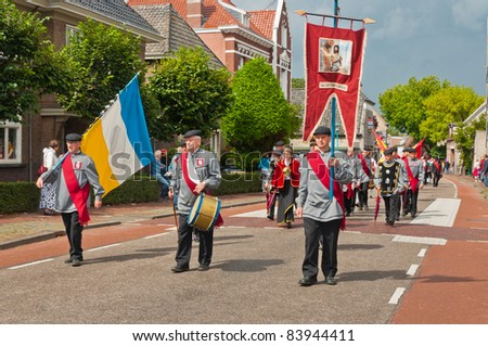 TERHEIJDEN, NETHERLANDS – AUG. 28: Guild Festival, members of St. Jans Guild from the Dutch village of Wernhout marching through the small village of Terheijden in the Netherlands on August 28, 2011.