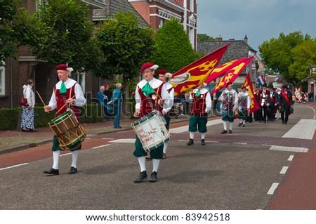 TERHEIJDEN, NETHERLANDS – AUG. 28: Guild Festival, members of the St. Sebastiaan Guild from the village of Oisterwijk walking through the village of Terheijden in the Netherlands on August 28, 2011