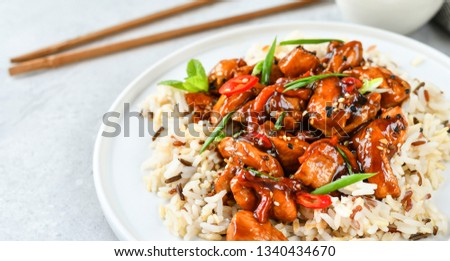 teriyaki chicken's  with chili pepper and sesame seeds, with rice. on a white plate, copy space, selective focus, Asian cuisine, Chinese cuisine, Thai cuisine. food flat lay. light background #1340434670