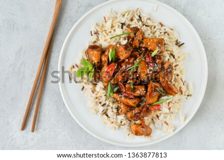 teriyaki chicken's  with chili pepper and sesame seeds, with rice. on a white plate, copy space, selective focus, Asian cuisine, Chinese cuisine, Thai cuisine. food flat lay. light background #1363877813