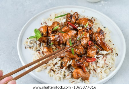 teriyaki chicken's  with chili pepper and sesame seeds, with rice. on a white plate, copy space, selective focus, Asian cuisine, Chinese cuisine, Thai cuisine. food flat lay. light background #1363877816
