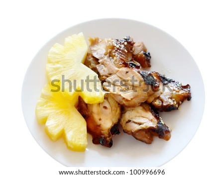 Teriyaki Chicken with fresh pineapple on white dish  - Japanese cuisine