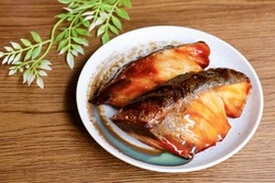 Teriyaki yellowtail. Grilled fish seasoned with sugar and soy sauce. A traditional Japanese seafood dish. A taste of winter.
