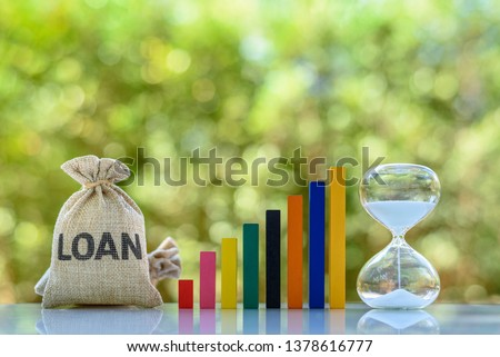 Term loan, financial concept : Loan bag, rising bar graph, hourglass on a table, depict loan from bank for specific amount, has specified repayment schedule with either fixed or floating interest rate