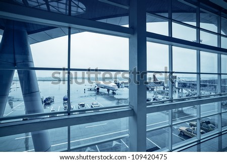 terminal outside,airport in the rain