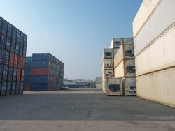 Terminal warehouse mortgage cargo container orange color forklift crane trade engineer technology transportation company factory logistic ecommerce international import export.Sky blue cloud white