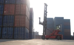 Terminal warehouse mortgage cargo container orange color forklift crane trade engineer technology transportation company factory logistic ecommerce international import export customer.Sky cloud white
