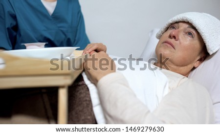 Terminally ill female patient refusing from meal, sad woman suffering disease