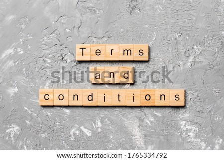 Terms and Conditions word written on wood block. Terms and Conditions text on table, concept. Stockfoto ©