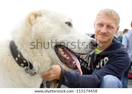 TERNOPIL-SEPTEMBER 09: Dog and man on Ternopil Regional exhibition of dogs on September 09, 2012 Ternopil, Ukraine