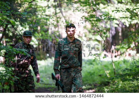 Ternopil, Ukraine, 27-05-2012. Military man ambush on the background of nature. Preparing to attack. #1464872444